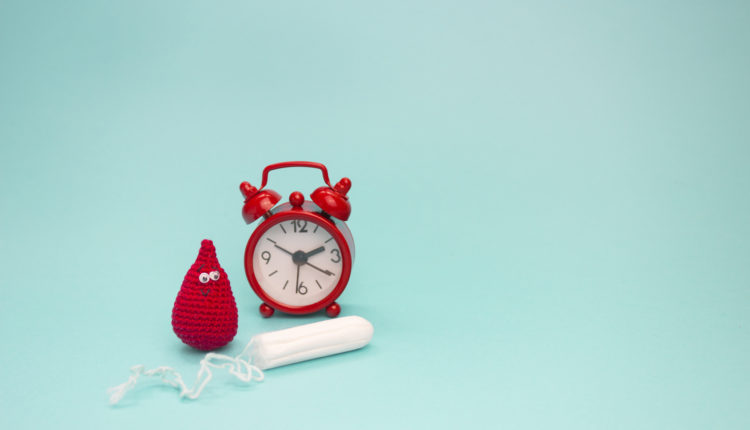 Smile crochet blood drop, menstrual tampon and red alarm clock. Menstruation sanitary woman hygiene. Woman critical days, gynecological menstruation cycle. Medical conception photo.